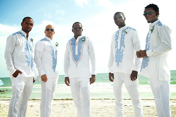 The groomsmen whereing shirts that match the waves on the beach at this modern and trendy Siesta Key destination wedding