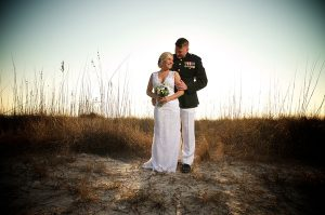 A groom in military dress at his destination beach wedding in Sarasota Florida.