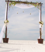Butterfly Garden wedding arch at a destination beach wedding in Sarasota Florida