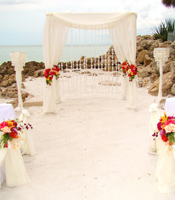 Coral Garden wedding canopy at a destination beach wedding in Sarasota Florida