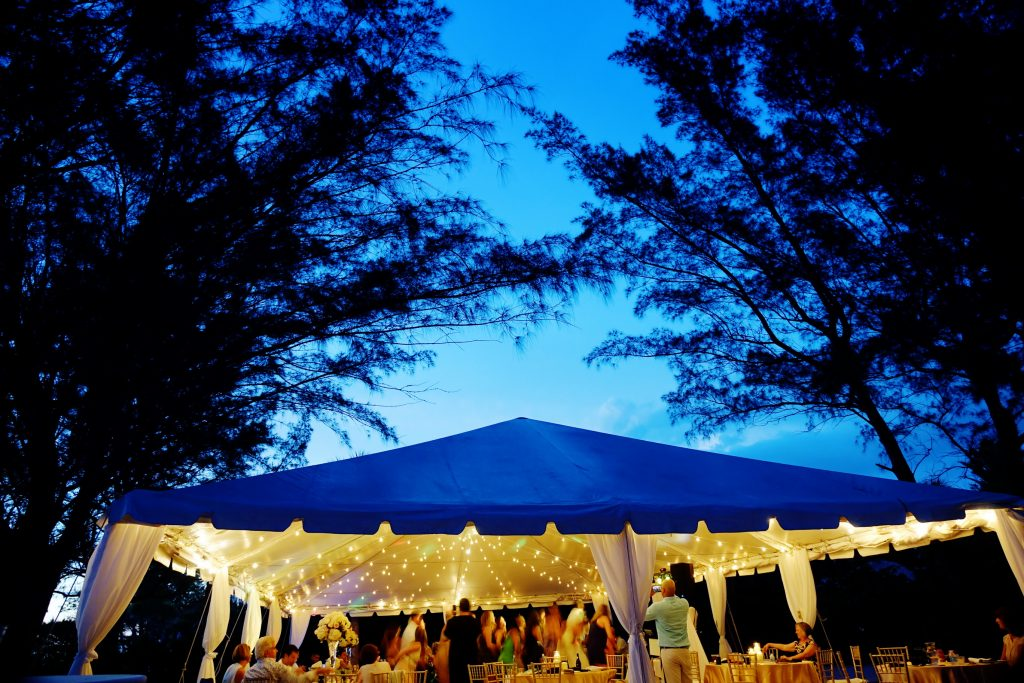 Sarasota beach wedding reception at night under the tent