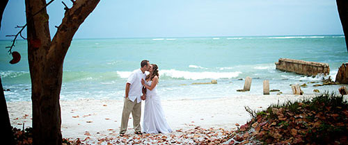 beach bridal couple kiss at their siesta key beach wedding