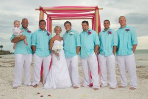 A bridal party wearing casual beach wedding attire during a Florida destination wedding.