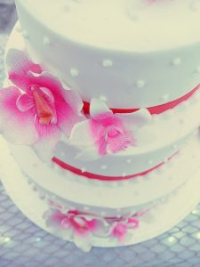 A lovely wedding cake decorated with tropical Hawaiian flowers