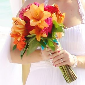 A beautiful tropical Hawaiian bouquet for the bride during a destination wedding in Sarasota Florida