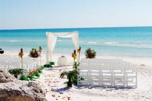 A tropical Hawaiian themed beach wedding on Anna Maria Island Florida
