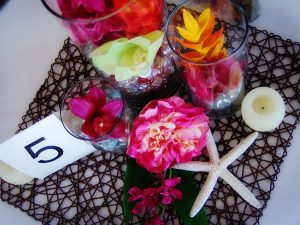 Using tropical Hawaiian decor for a wedding table centerpiece - by Sand Petal Weddings