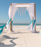 Hawaiian Breeze wedding canopy at a destination beach wedding in Lido Key Florida