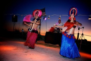 Polynesian dancers at a tropical Hawaiian beach wedding in Anna Maria Island Florida