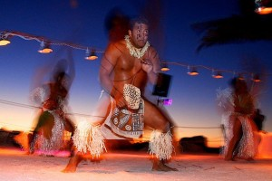 A Polynesian fire twirler during a destination wedding in Anna Maria Island Florida