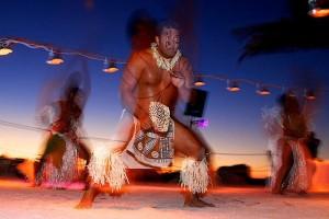 A Polynesian fire twirler during a destination wedding in Anna Maria Island Florida