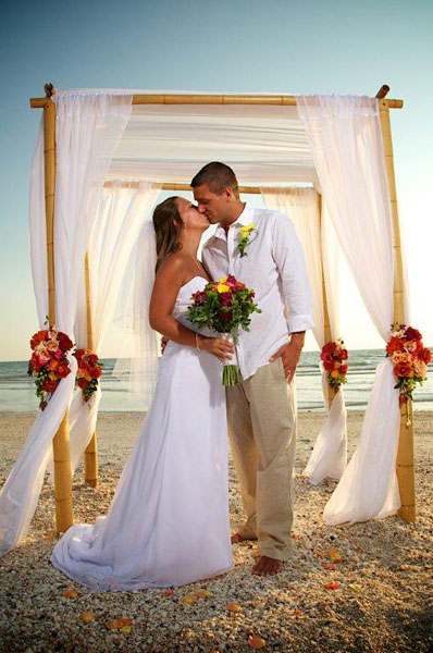 Bride And Groom Share A First Kiss During Their Destination Beach Wedding On Lido Key In Sarasota Florida