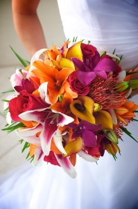A bride's tropical Hawaiian bouquet during a beach wedding in Sarasota Florida