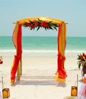 Tropical Sun wedding canopy at a destination beach wedding in Anna Maria Island Florida